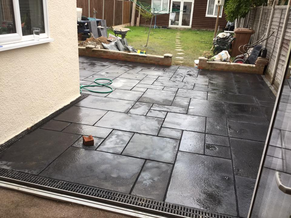 Dark grey concrete flooring in the backgarden