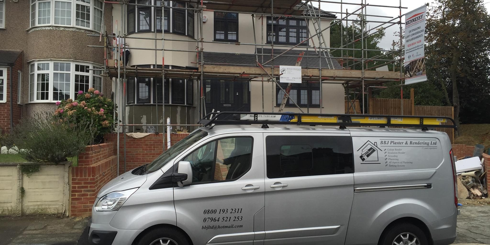 Parked BBJ Plaster & Rendering van outside a large house with its walls being skimmed and rendered