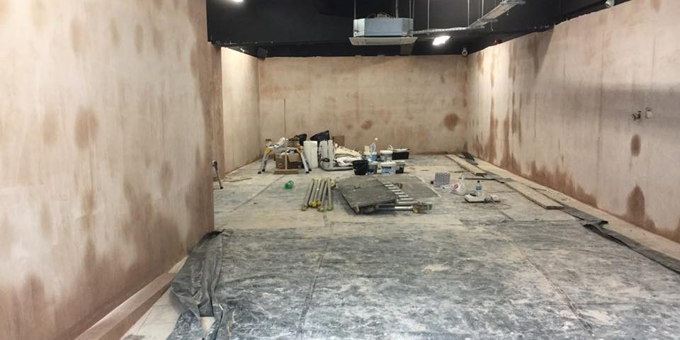Unfinished commercial space showing unplastered walls.